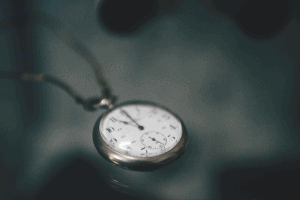 Stopwatch against abstract, lowlight backdrop
