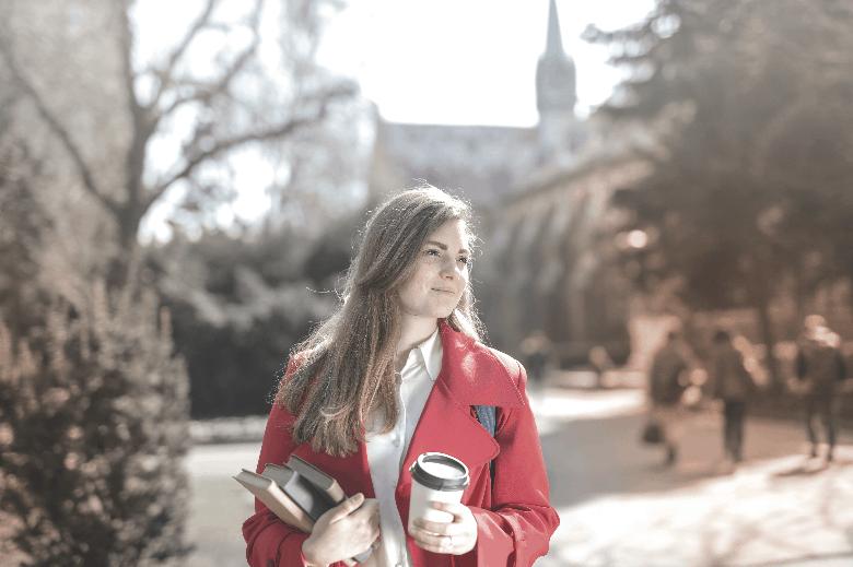 Young woman walking to class.