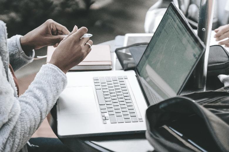 Woman writing an LSAT essay on her laptop.